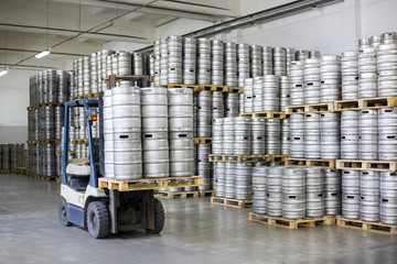 Autoloader loading beer kegs in stock brewery