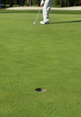Golfer lines up putt on a green