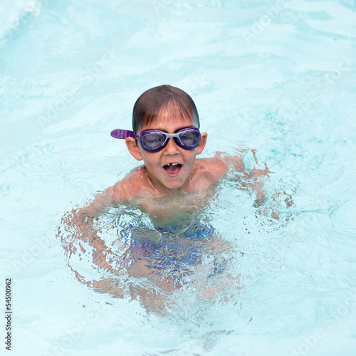 Little boy at the swimming pool