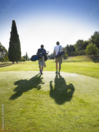 Men walking on golf course
