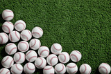 Baseballs on green turf viewed from above