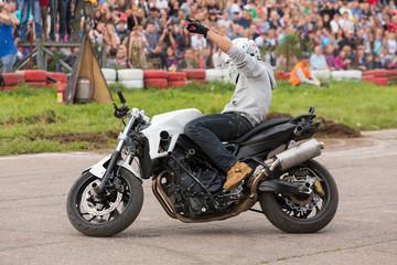 Biker stunt shows on motorcycle