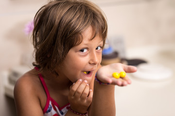 Girl eating yellow candy