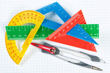 Instruments for drawing in school. Ruler and compass. Close-up.