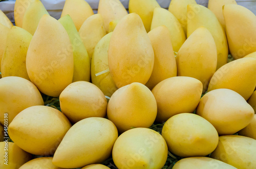 Pile of fresh Barracuda mango on sales in Thailand open market