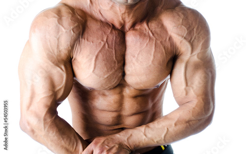 Muscular torso, and arms of male bodybuilder