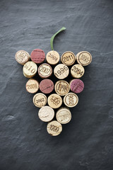 Wine: Corks in grape shape on slate