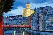 canvas print picture - Girona by night with cathedral and decorated bridge