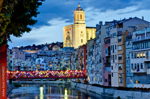 canvas print picture Girona by night with cathedral and decorated bridge