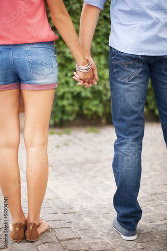 Part of couple with holding hands
