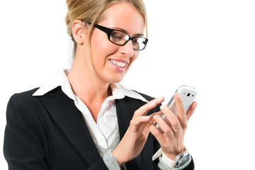 Young woman using her mobile phone for texting