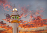 Al Fateh Mosque Minaret on dramatic cloud at sunset