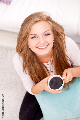 woman sitting on floor with coffee