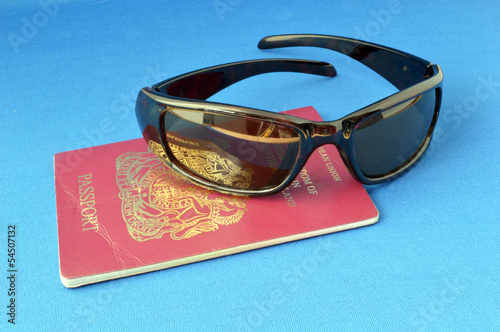 Sunglasses and Passport