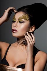 elegant fashionable woman with art visage