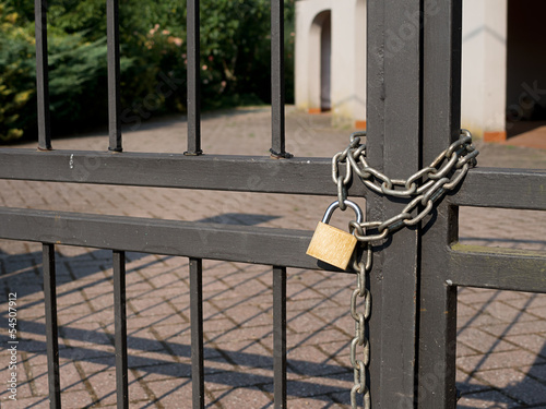 Locked out - house with padlock, chain