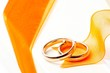 gold wedding rings orange ribbon