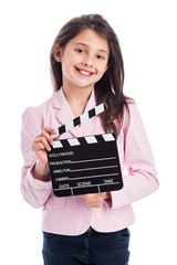 Smiling Young Girl with Clapperboard.