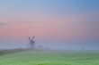 windmill silhouette over sunrise sky