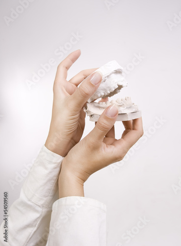 Dental Casting - hands holding dental gypsum models, dental conc