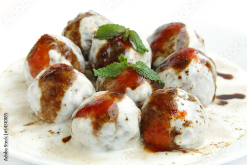 Delicious banana dahi vada in a plate