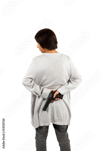 Smart woman put the gun behind her back. Isolated against white