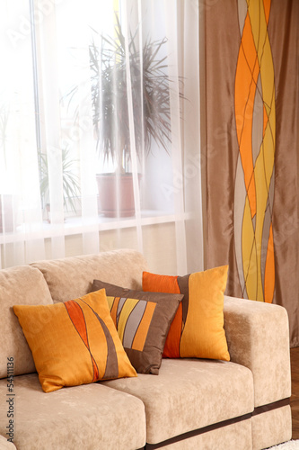 decorative pillows on a beige sofa