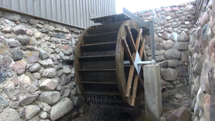 new decorative watermill wheel in motion