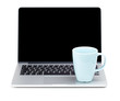 Tea cup on laptop