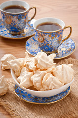 White-cream meringue on plate and coffee