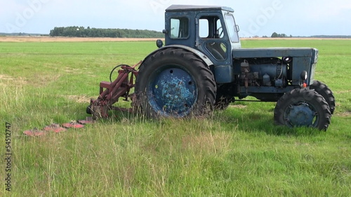 old tractor lawn mower on airfield
