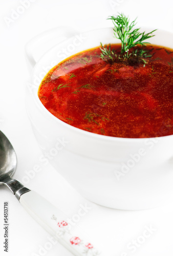 Red beetroot soup on white background