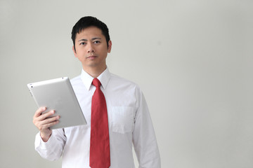 Asian businessman holding a tablet