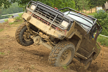 Off-road vehicle on top of a steep hill