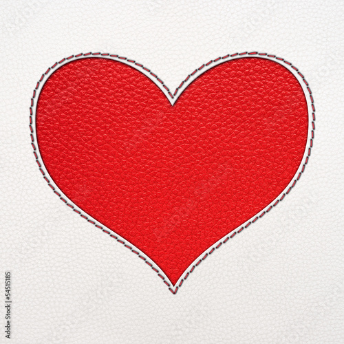 Heart from red and white leather background