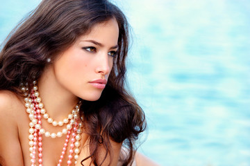 woman with pearls necklace