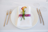 Exotic theme table setting. Decor with fresh calla
