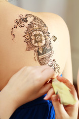 henna applying on the back