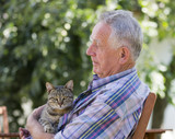 Senior man with cat