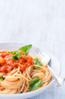 Spaghetti with tomato sauce and fresh basil herb