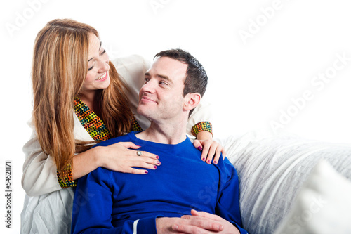 Young couple relaxing on the sofa