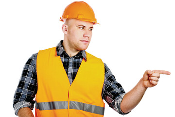 A young construction worker pointing something