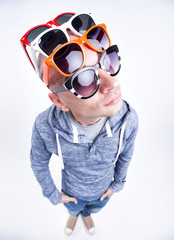 funny man with pairs of sunglasses on his head - studio shot