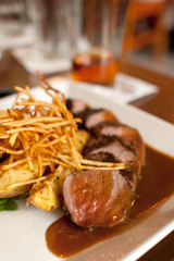 Cut beef steak frites with sauce