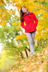 Autumn woman happy lifestyle in fall forest