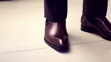Business man with suit and brown leather shoes