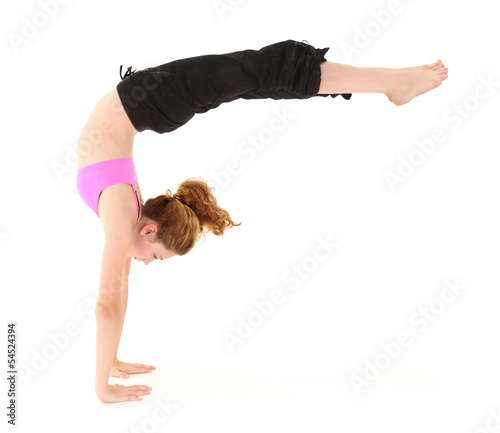 Beautiful strong child in a handstand with legs held out. Clippi