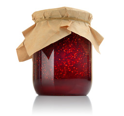 Raspberry jam in a jar on white background