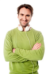 Smart male with headphones around his neck