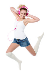 Music lover jumping high in the air